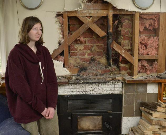 Amelia Seales woke during the middle of the night to find her Normanby flat rapidly filling with...