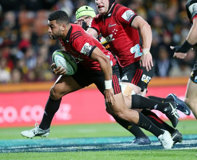 Crusaders first five Richie Mo'unga breaks the Chiefs defence. Photo: Getty Images