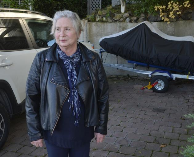 Glenda Alexander stands in the  space in her carport left after the burglary of one of her jet...