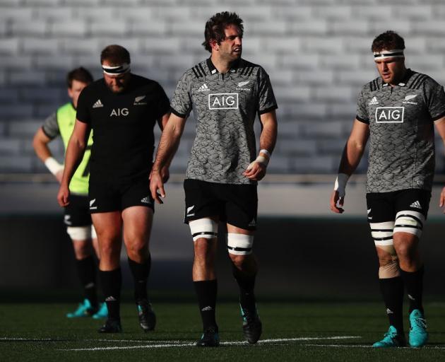 Joe Moody with Sam and Luke Whitelock at All Blacks training this week. Photo: Getty Images