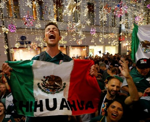 Mexico's fans celebrate victory of their team after the match. Photo: Reuters