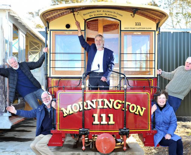Celebrating the delivery of cable cars to Mornington are (from left) Trevor Goudie, Mac Gardner, Neville Jemmett, Claire Goudie and Stuart Payne. Photo: Christine O'Connor