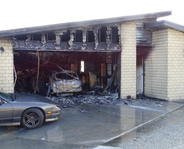 A car, garage and part of a residential property in Lake Hayes Estate, between Arrowtown and Frankton, sustained significant damage after the car went on fire early yesterday morning. Photo: Tracey Roxburgh