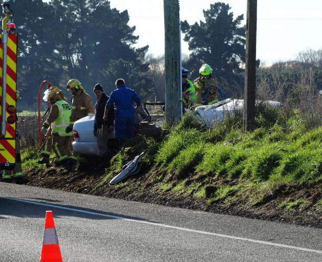 Emergency services at the scene of a single-vehicle crash north of Oamaru this morning. PHOTO: DANIEL BIRCHFIELD