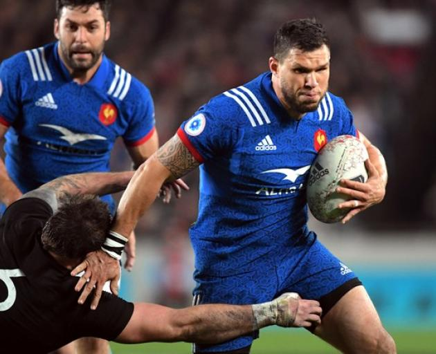 France's Remy Grosso is tackled by New Zealand's Liam Squire. Photo: Reuters