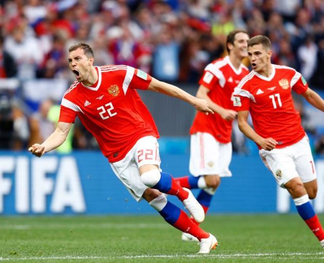 Artem Dzyuba celebrates scoring in Russia's win over Saudi Arabia at the football World Cup....
