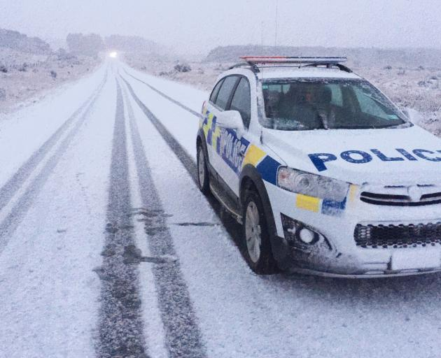 A police car is one of the few vehicles on this stretch of road near Queenstown yesterday.