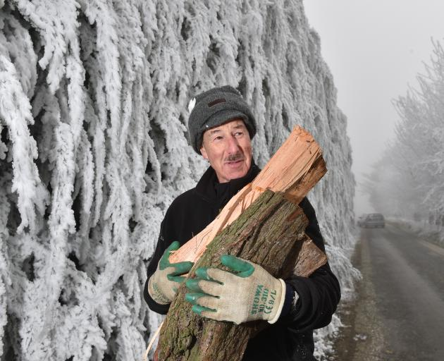Rod Baxter, of Alexandra, spent yesterday afternoon helping his brother Euan split macrocarpa to...