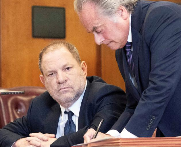Harvey Weinstein (left) with lawyer Benjamin Brafman at the Manhattan Criminal Court on Tuesday....