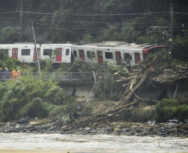 Derailed train caused by a landslide following heavy rain is seen in Karastu. Photo: Reuters