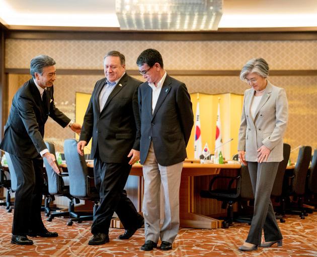 U.S. Secretary of State Mike Pompeo, Japan's Foreign Minister Taro Kono and South Korea's Foreign...