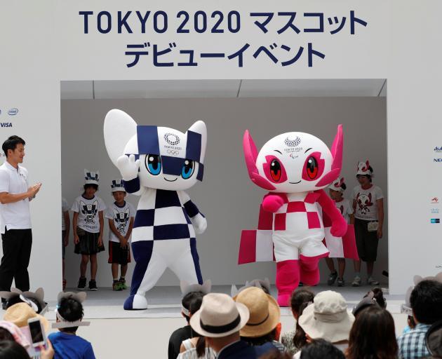 Japan's Olympic swimmer Daiya Seto and Japan's Paralympic canoeist Monika Seryu look on as Tokyo...