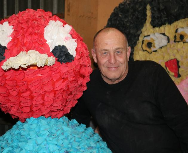 Alexandra Blossom Festival event manager Martin McPherson is surrounded by floats for the festival made with crepe paper, which is now hard to obtain in New Zealand. Photo: Tom Kitchin