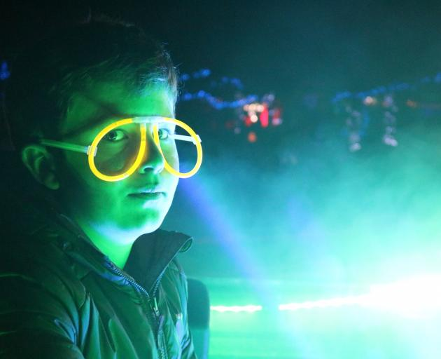 Jack Farrell, of Alexandra, glows among the surrounding lights at his festival on Saturday, which...