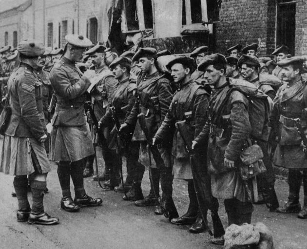 The famous Black Watch in a village answering a roll call prior to going into the firing line. — Otago Witness, 24.7.1918.