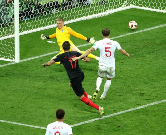 Mario Mandzukic of Croatia scores past England goal keeper Jordan Pickford to give it the lead....