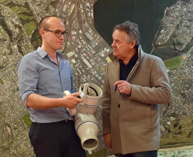 Dunedin City Council 3 Waters manager Tom Dyer explains the inner workings of a reflex valve to Greater South Dunedin Action Group president Ray Macleod at a public information session in South Dunedin yesterday. Photo: Peter McIntosh