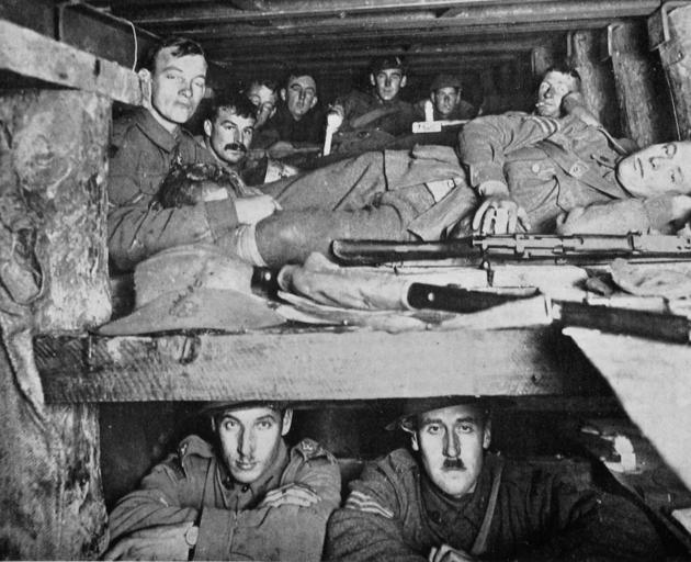 The congested interior of a dug-out below ground, somewhere in France. — Otago Witness, 31.7.1918.