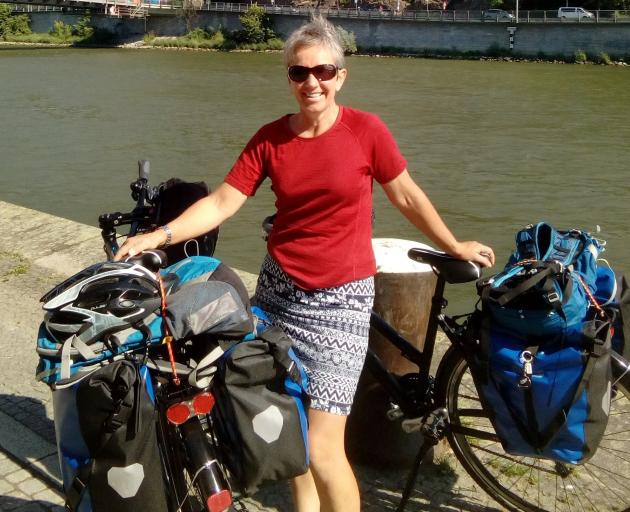 Jenny Malcolm stops for a photograph during a recent cycling tour in Europe. Photo: Supplied