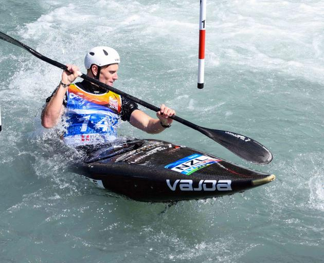 Alexandra paddler Finn Butcher navigates a gate at the canoe slalom under-23 and junior world...