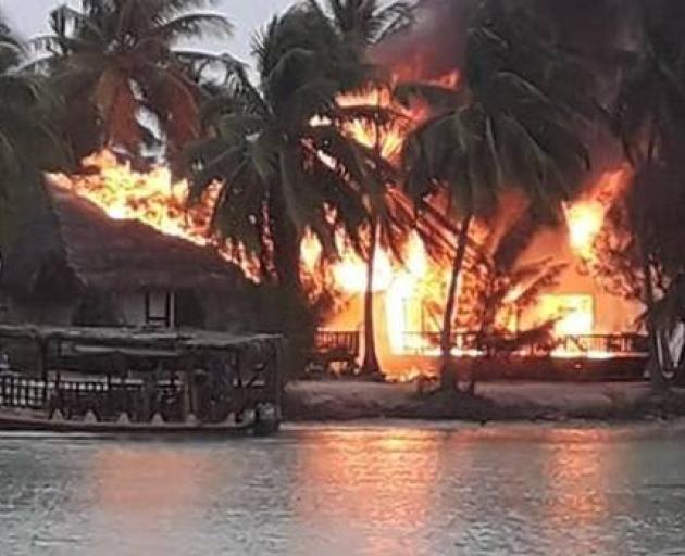 The Aitutaki Lagoon Resort & Spa up in flames. Photo: Annita Cyprien Drollet via NZ Herald