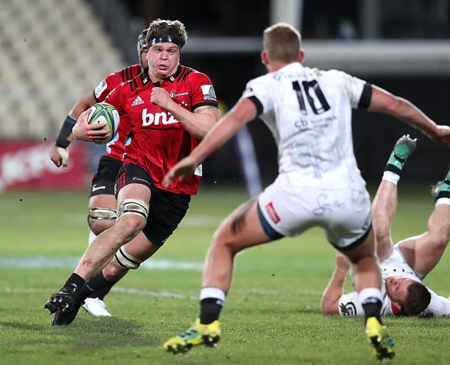 Scott Barrett of the Crusaders makes a break during the Super Rugby Qualifying Final match...