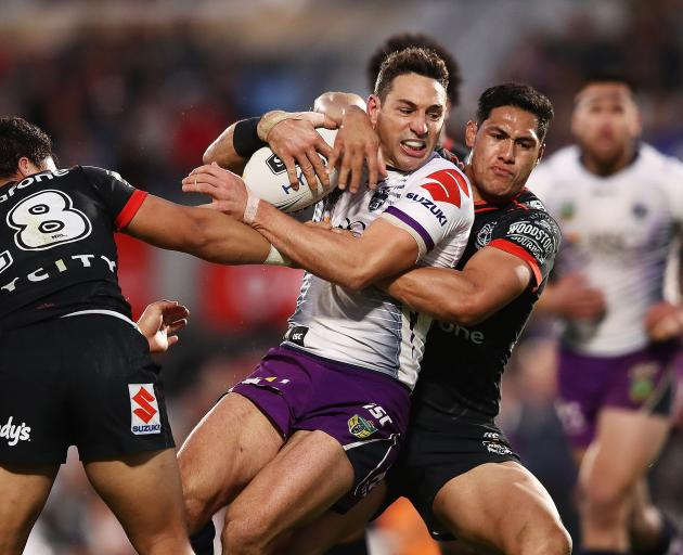 Billy Slater of the Storm charges forward during the round 19 NRL match between the New Zealand...