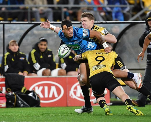 Augustine Pulu of the Blues is tackled by Jordie Barrett. Photo: Getty Images