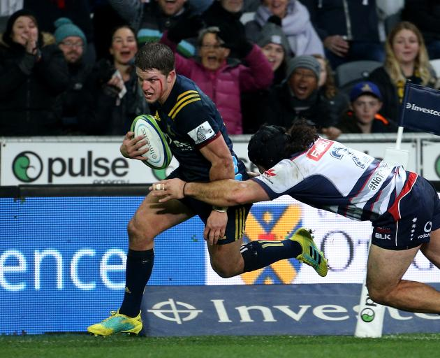 A bloodied Teihorangi Walden runs in a try for the Highlanders in their win over the Rebels...