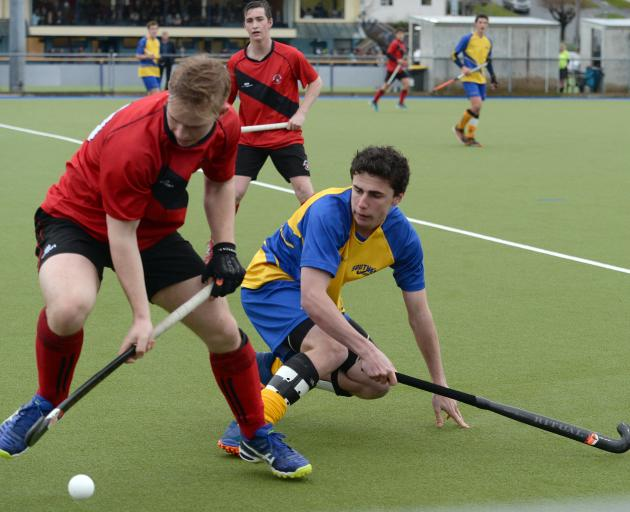 Canterbury player William Duston (left) is closely marked by Southern player James Nicolson...