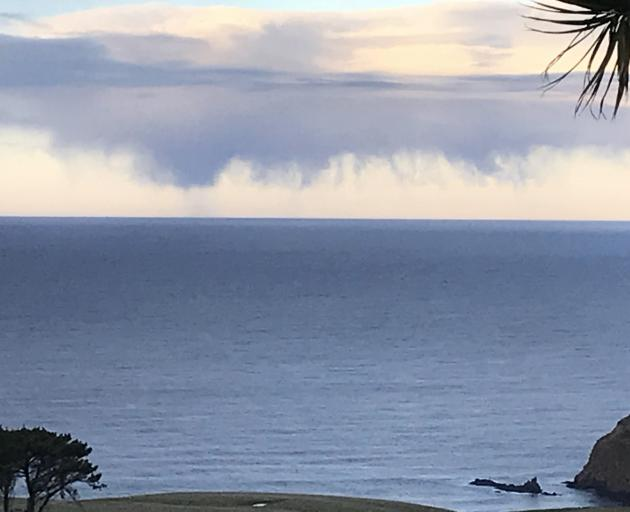 Virga trails from a bank of altocumulus east of Cape Saunders on Sunday afternoon. Wilma McKay photographed the unusual cloud - a result of precipitation evaporating before it reaches the surface - from her deck. Photo: Wilma McKay