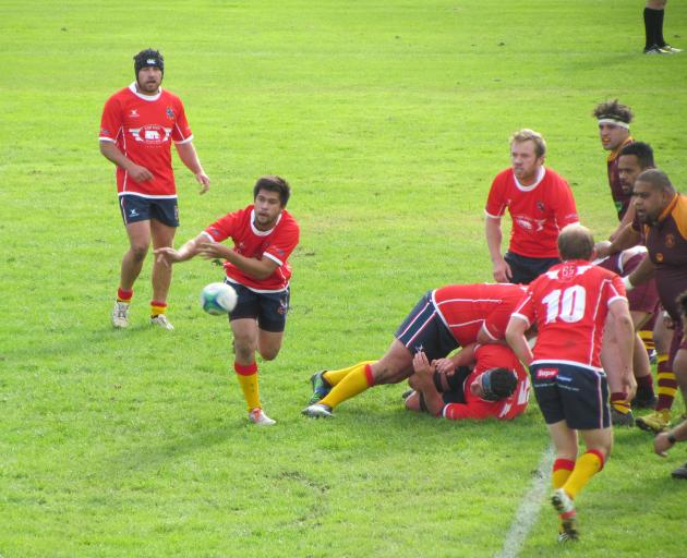 Kurow halfback Glen Robertson clears the ball from a ruck during the Citizens Shield club rugby...