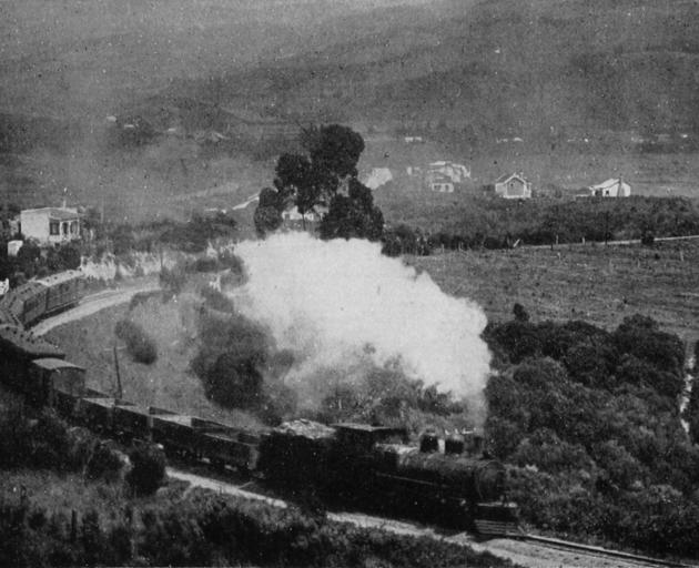 The morning train puffs its way out of Waitati, bound for Dunedin. - Otago Witness, 17.7.1918.
