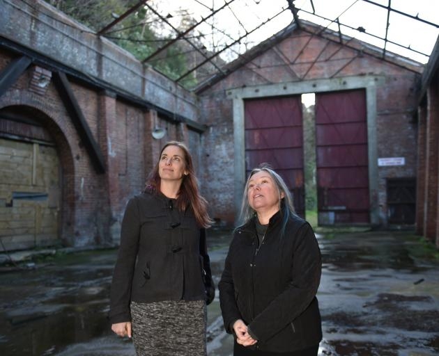 Dunedin City Council acting general manager of infrastructure and networks Leanne Mash (right) and her personal assistant Kimberley Lamond inspect the interior of the former Sims Engineering building in Port Chalmers earlier this week. Photo: Gregor Richa