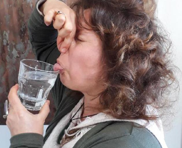 Clean water campaigner Jennifer Rumore is not pleased with Queenstown Lakes drinking water. PHOTO...