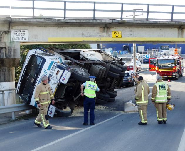 A truck lies on its side after hitting a rail overbridge in Humber St in Oamaru yesterday. Photo:...