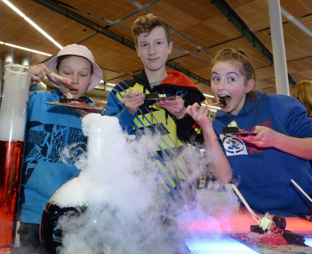 King's High School pupils Leo Etuata and Josiah Trounson (both 13), and Tahuna Normal Intermediate pupil Billie Askerud (12) enjoy chocolate brownies at Otago Polytechnic during a New Zealand International Science Festival event yesterday. Photo: Linda Ro