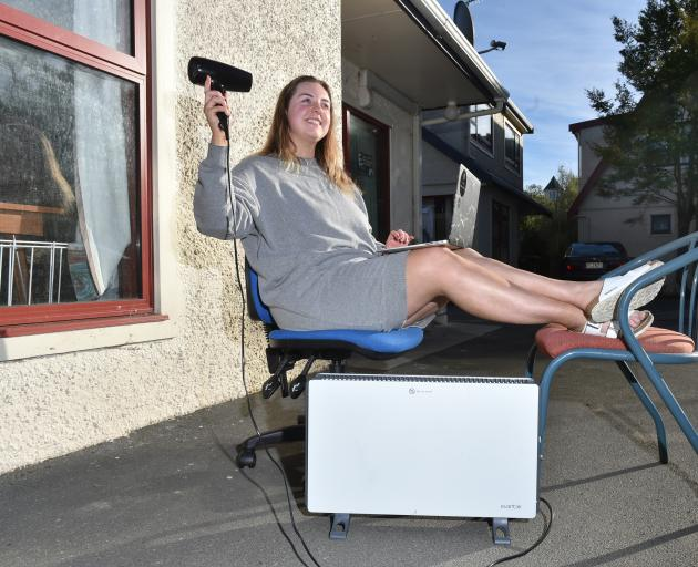 Harbour Tce resident Kacee Grant tries not to let regular power cuts faze her. Photo: Gregor Richarsdon