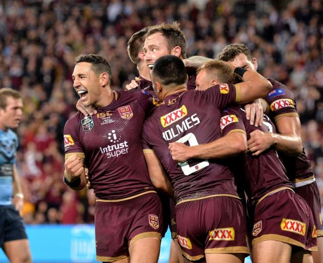 Queensland players celebrate a Daly Cherry-Evans try in last night's State of Origin game three....