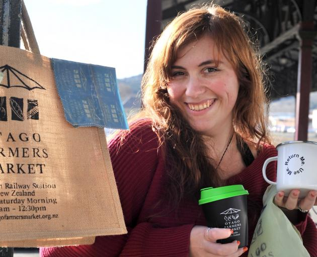Otago Farmers Market administrator and duty manager Scarlett Michelle with some of the reusable...