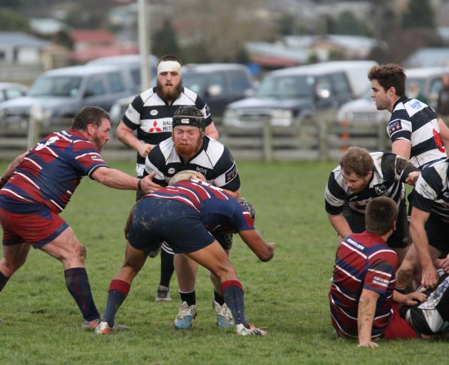 Crescent prop Logan Morrell tries busting through the tackle of Clutha Valley back Crewze Kingi...