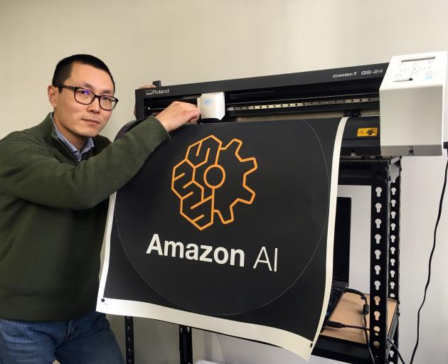 Happy Moose founder Alex Dong checks the knife on a cutter creating a dot decal for electronic commerce giant Amazon in Dunedin last week. Photo: Shawn McAvinue