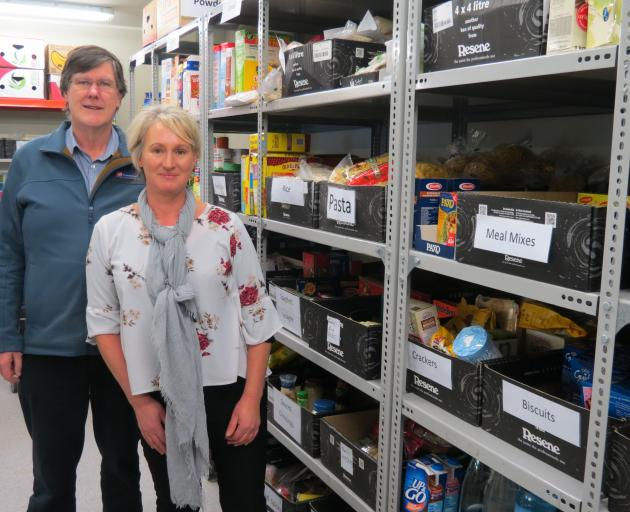 Salvation Army Community Ministries manager David McKenzie and Foodbank co-ordinator Gail Geels are looking for community support to top up stocks. Photo: Brenda Harwood