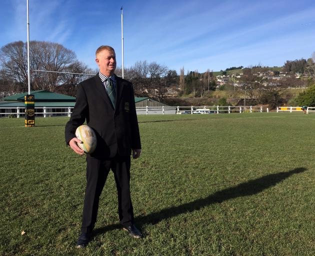 Green Island Rugby Football Club president Craig Anderson admires a dry rugby ground at Miller Park in Abbotsford on Saturday. Photo: Shawn McAvinue