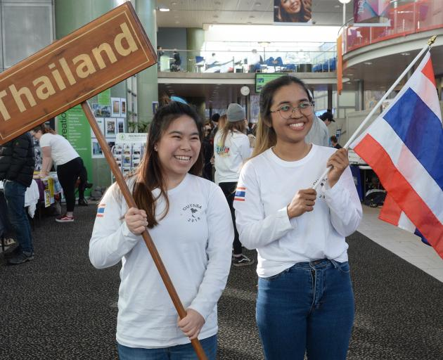 Runchita Ovararint (left) and Mina Saengchan were still smiling at yesterday's clubs and societies day at the University of Otago, after learning of the rescue of 12 boys and their football coach from a flooded cave in Thailand. Photo: Linda Robertson
