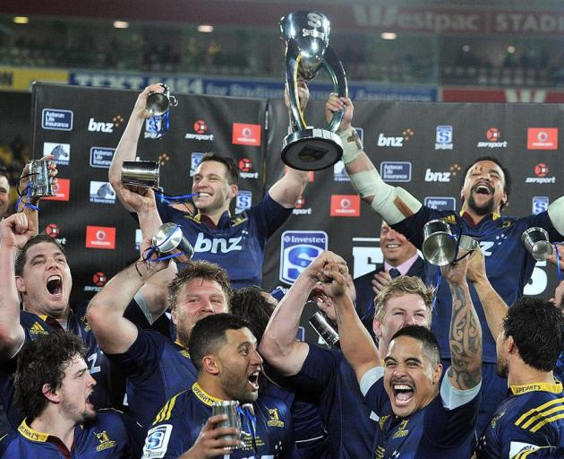 The Highlanders celebrate winning the Super rugby final in Wellington in July. Photo by Craig...
