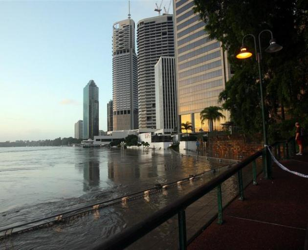 The riverside walkways on the fringe of Brisbane's central business district were awash yesterday...