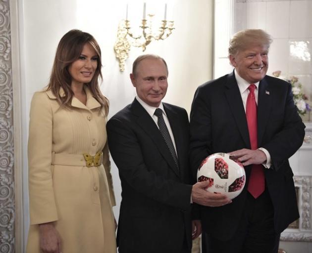 Russia's President Vladimir Putin, US President Donald Trump (R) and First lady Melania Trump. Sputnik/Alexei Nikolsky/Kremlin via Reuters