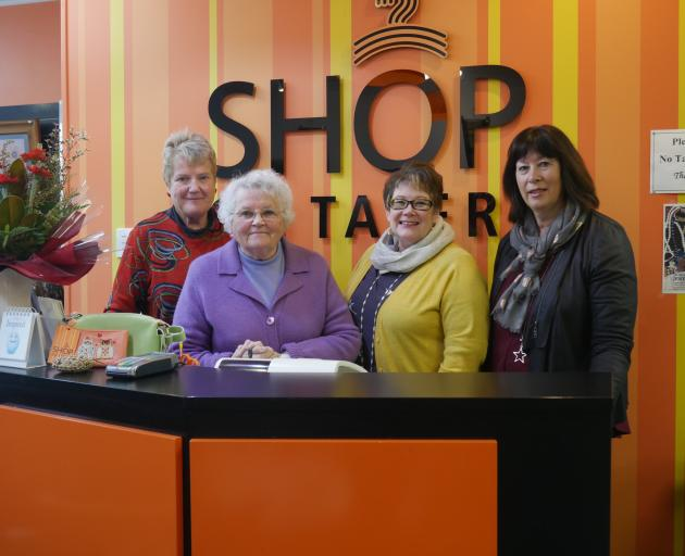 Shop on Taieri staff (from left) volunteer Elaine Mason, volunteer Mersailie Sayers, manager Fiona Smaill (far right) and Saddle Hill Foundation Trust representative Lisa Wells in the shop on July 2. Photo: Jessica Wilson