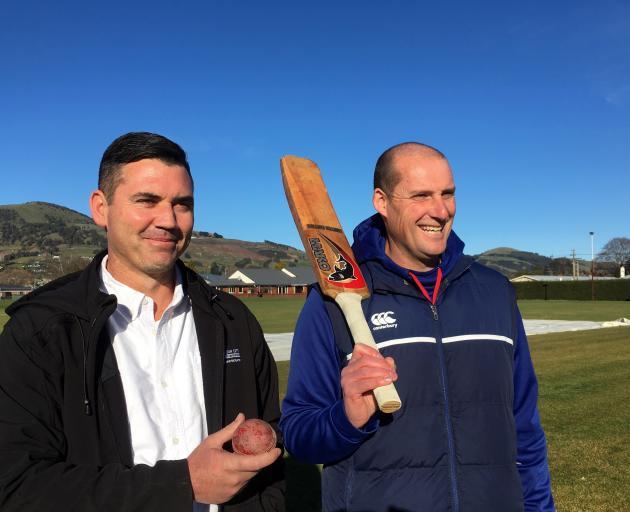 Dunedin City Council parks maintenance team leader Nick Maguire (left) and Taieri Cricket Club senior coach Michael MacKenzie inspect Brooklands Park. Photo: Shawn McAvinue